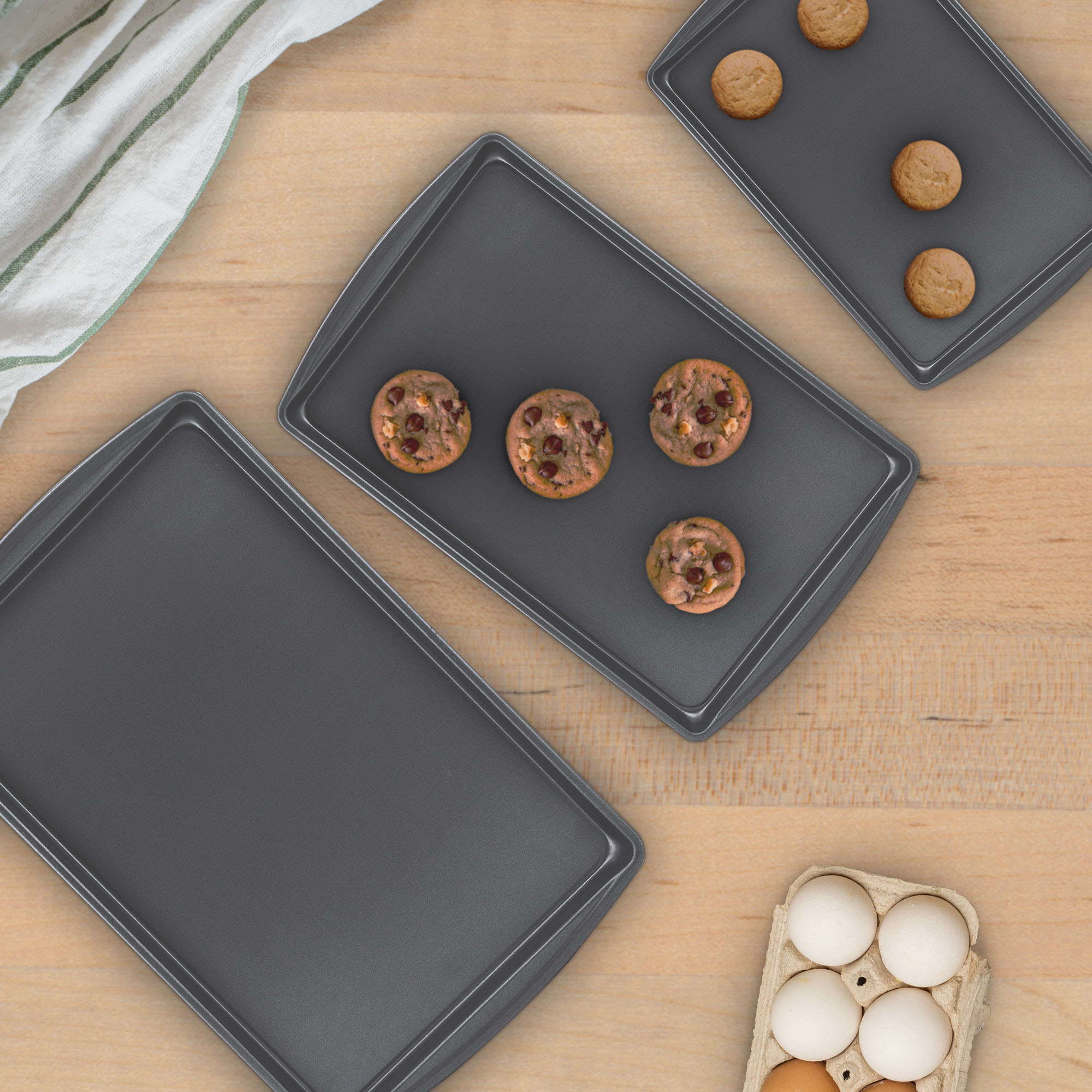 three sheet pans on a counter
