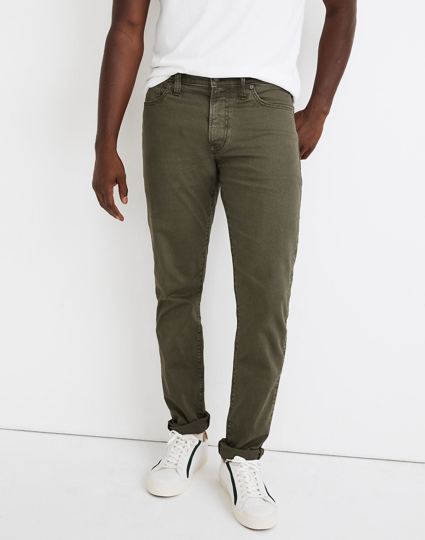 Model wearing Madewell garment-dyed athletic slim jean everyday flex jeans in deep green