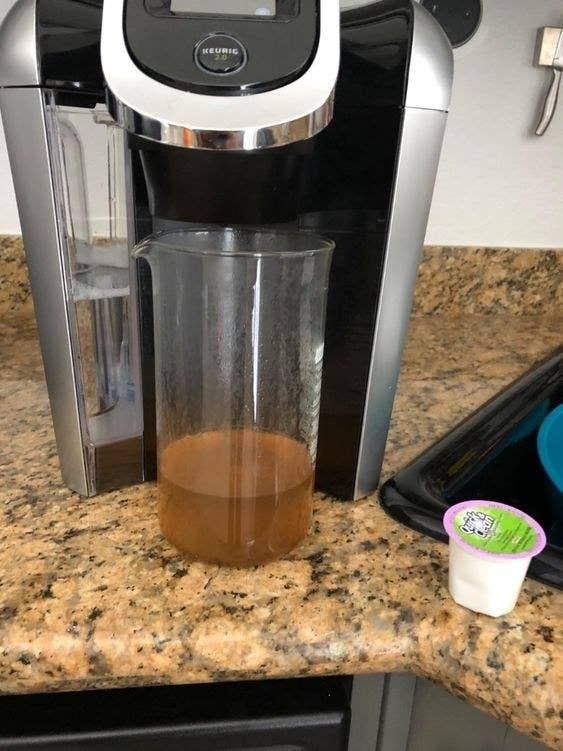 A reviewer photo of dirty-looking liquid that was cleaned out of the Keurig with the pod