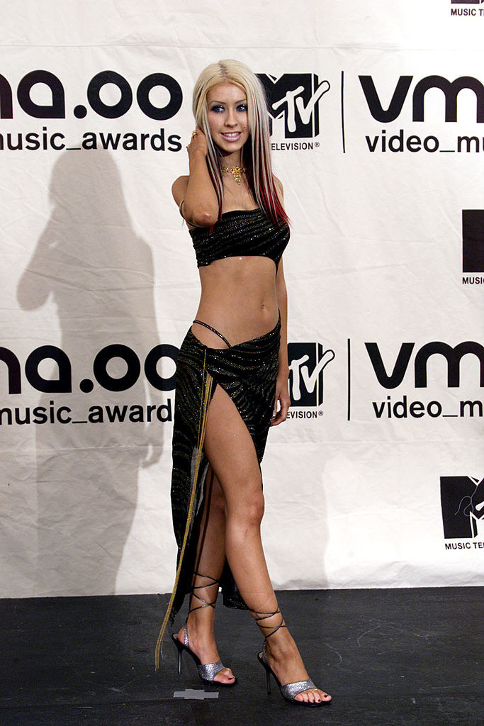 xtina with a thong strap showing