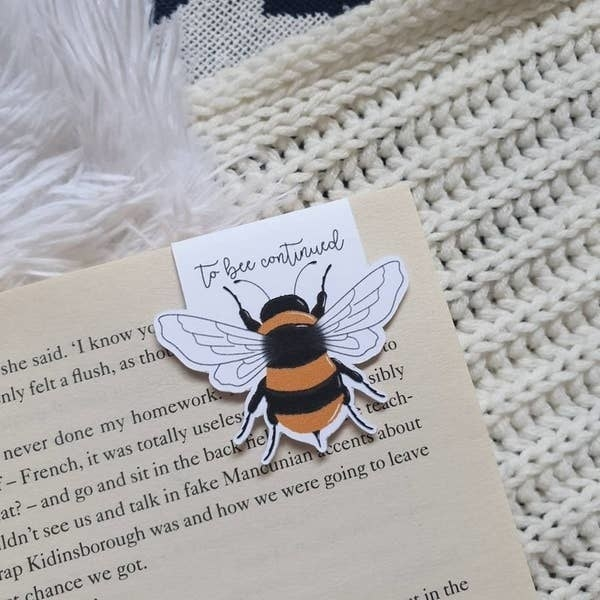 The bookmark saving a page in an open book