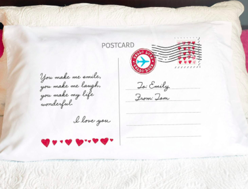 Postcard-themed pillowcase with a personalized love message on the front