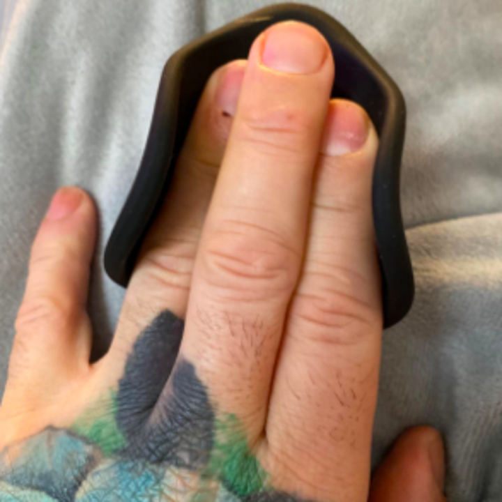 Different reviewer pressing three fingers into brace, showing stretchability