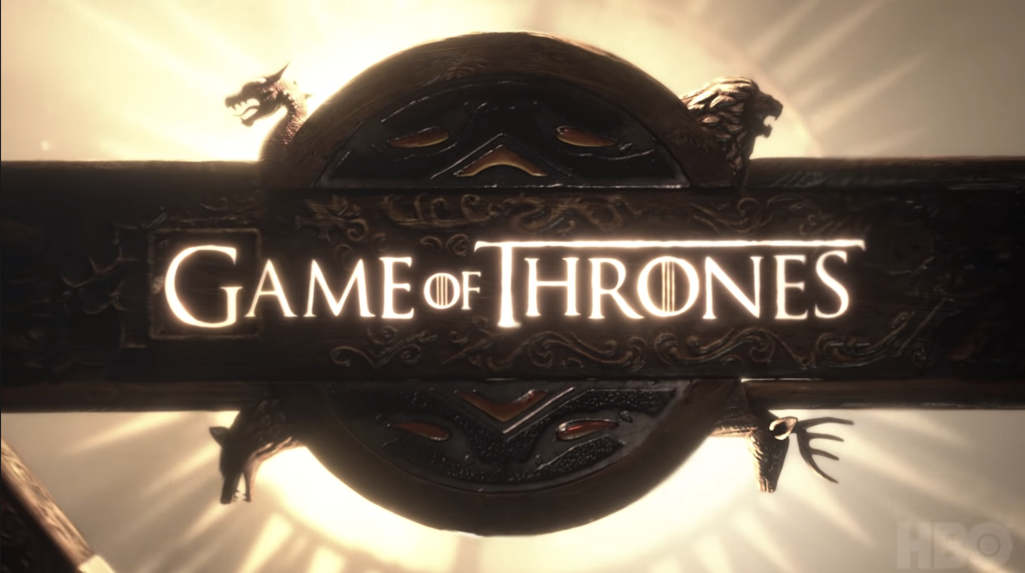 """GoT"" title card — which is the title of the show branded into an iron circle."