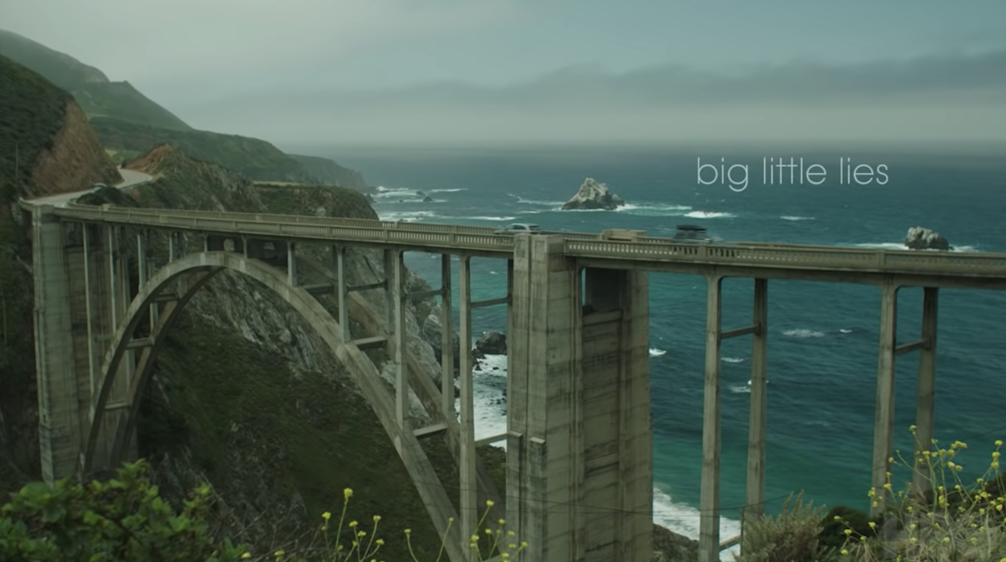 """Big Little Lies"" title card — which is the title of the show over a bridge in Monterey, CA."