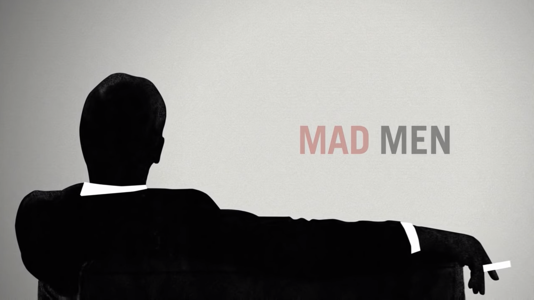 """Mad Men"" title card — which is the title over a silhouette of a sitting man smoking a cigarette."