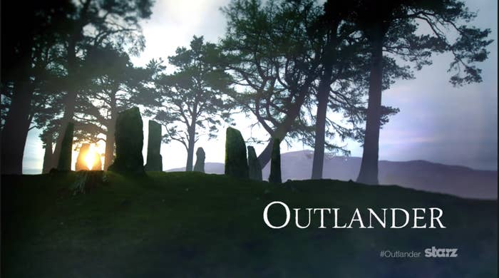 """Outlander"" title card — which is the show title over the rocks of Craig Na Dun in Scotland."