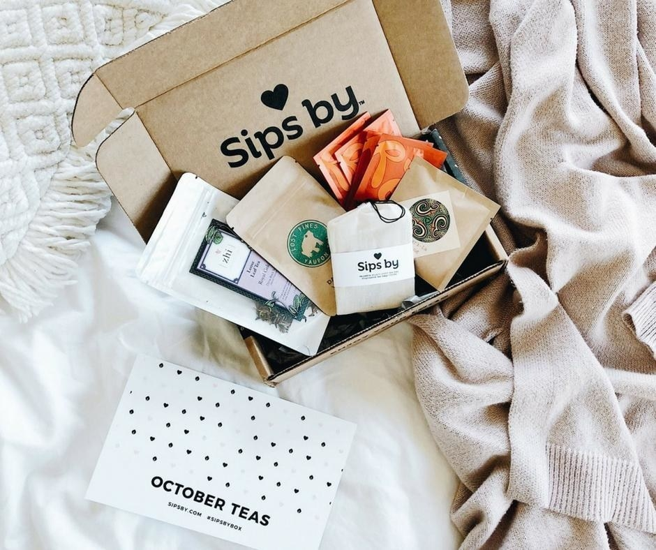 The box with several packets of loose leaf tea inside