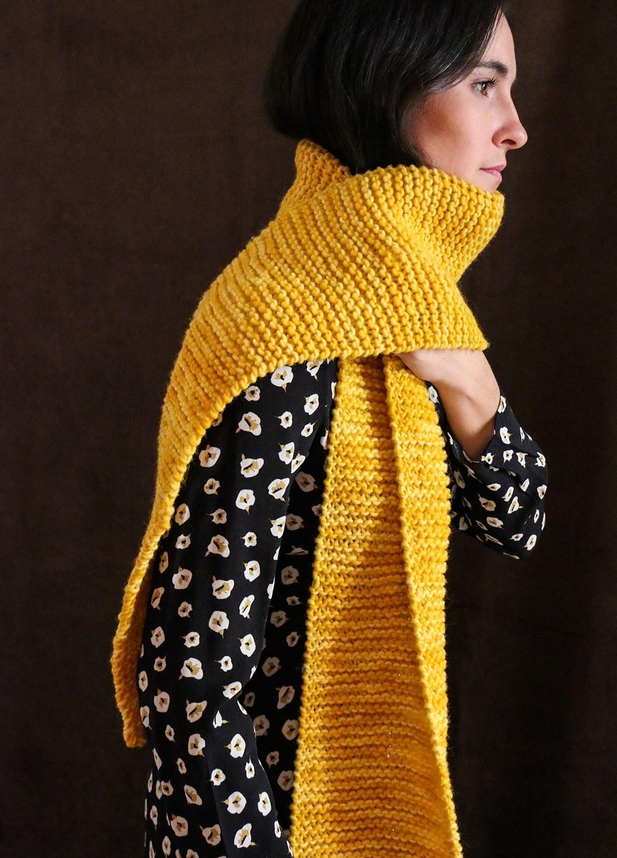 model wearing long yellow garter stitch scarf