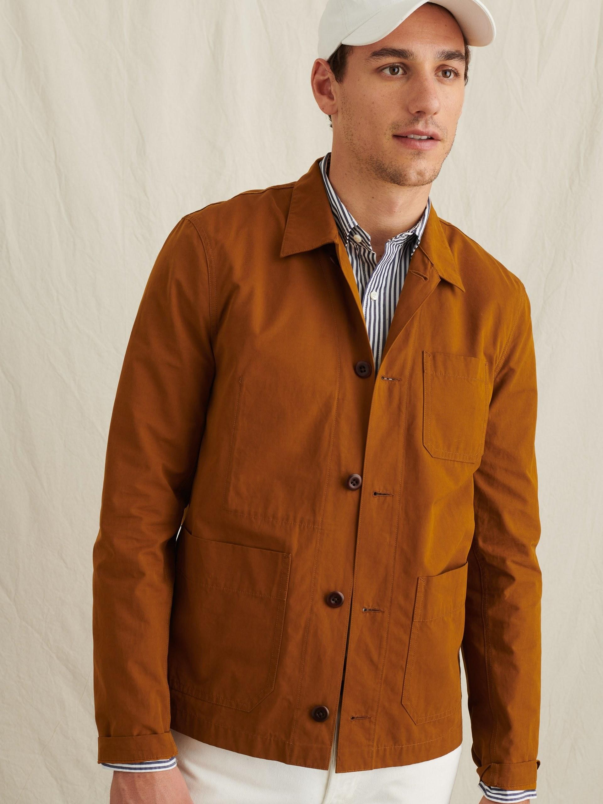 Model wearing Alex Mill garment-dyed work jacket in toffee