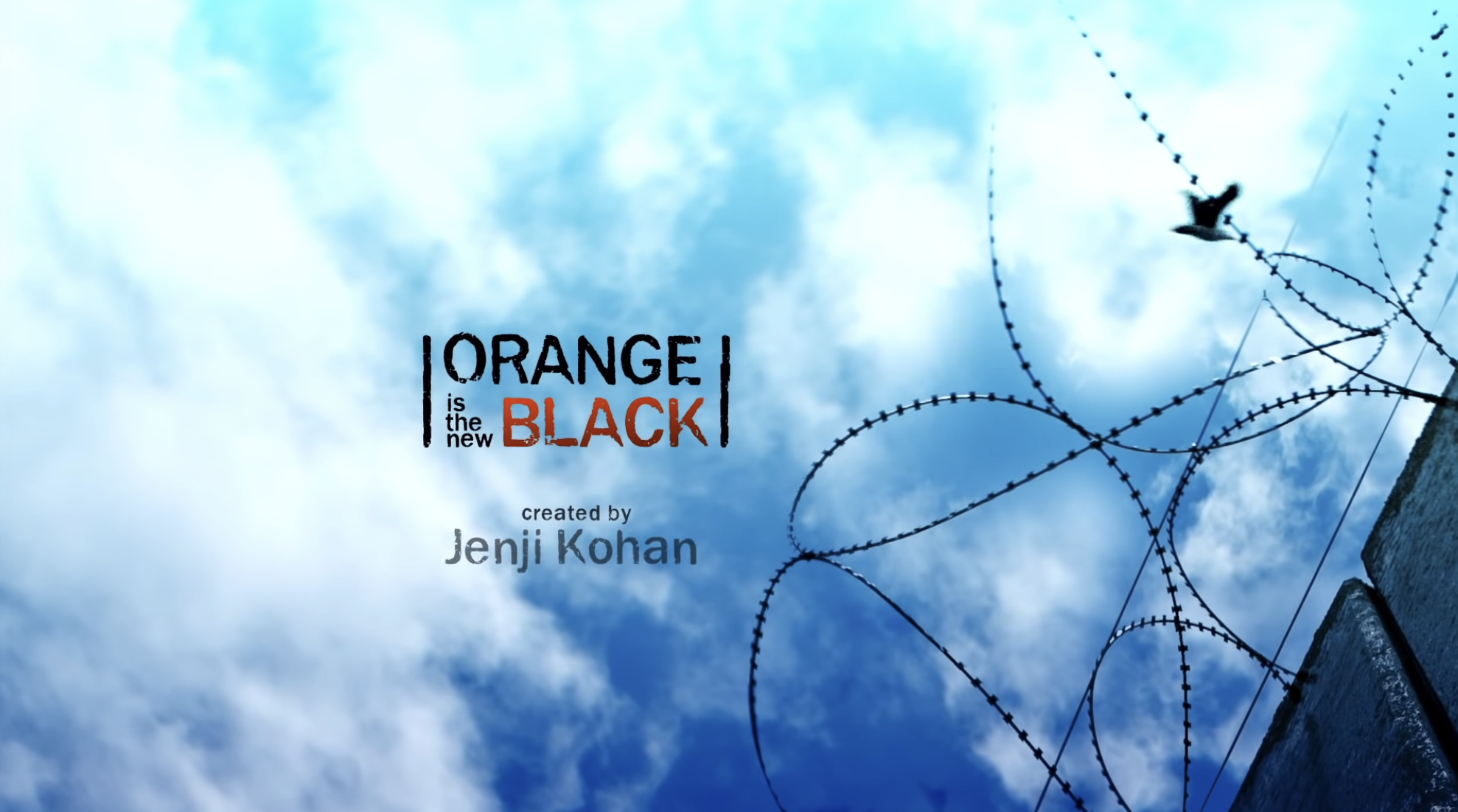 """OITNB"" title card — which is the title in the sky over a prison yard."
