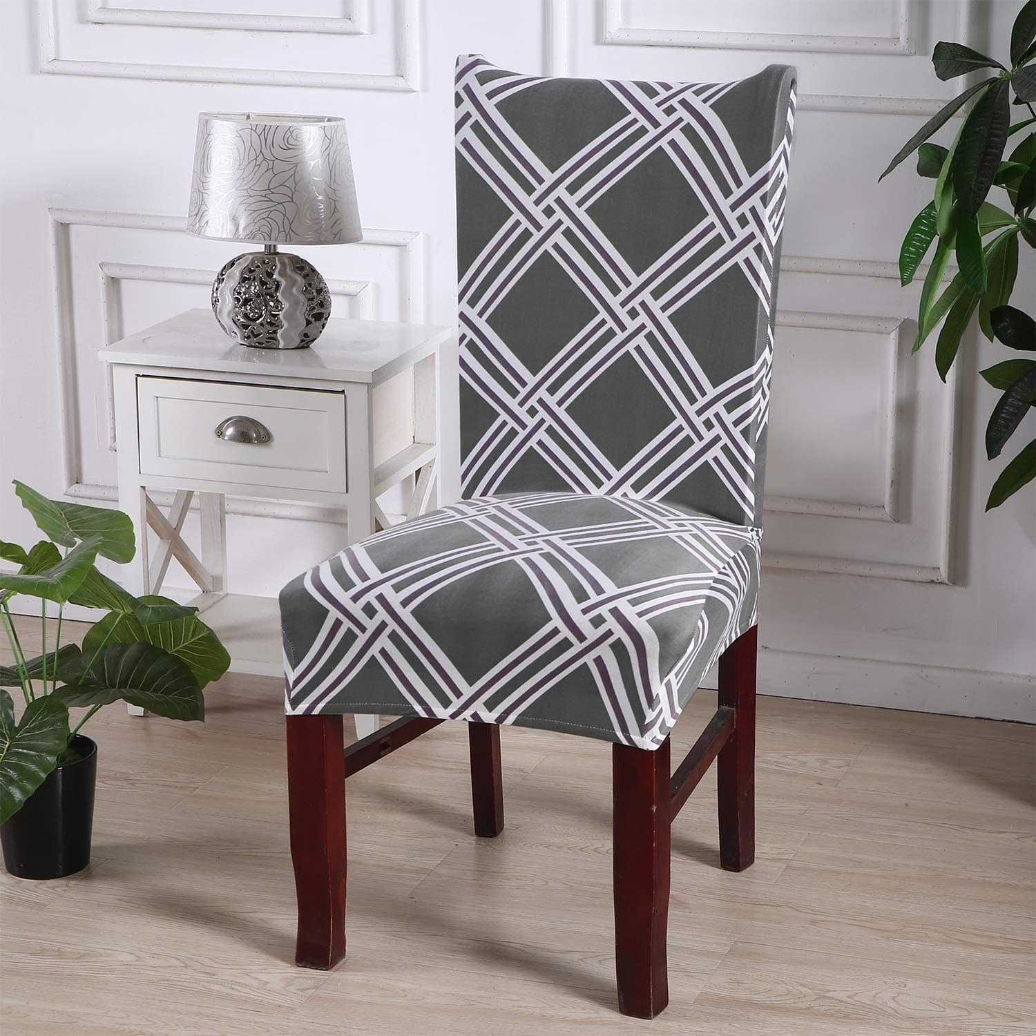 A chair with a patterned slipcover over it