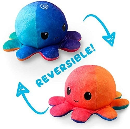Octopus plush that is orange and smiley on one side and blue and frowny on the other