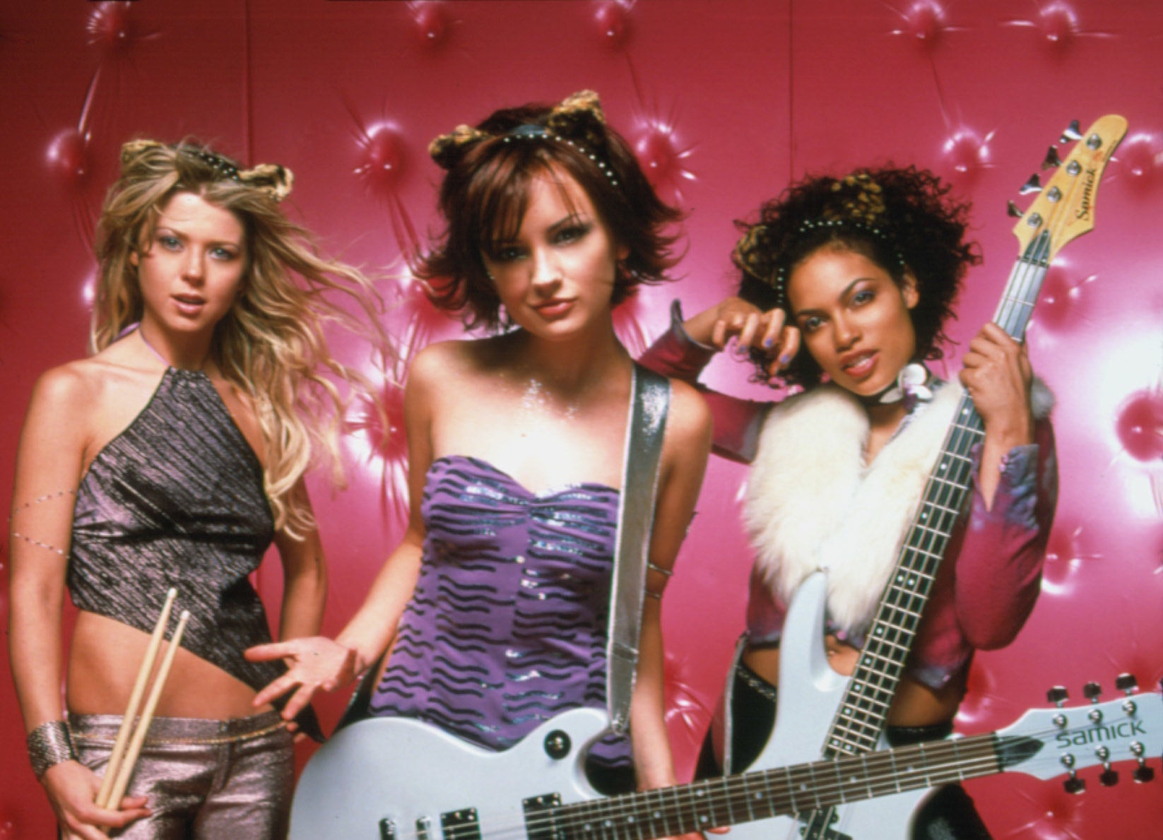 A publicity photo of Tara Reid, Rachael Leigh Cook, and Rosario Dawson with kitty ears taken for the movie