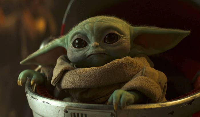 Baby Yoda looking real cute in his space crib