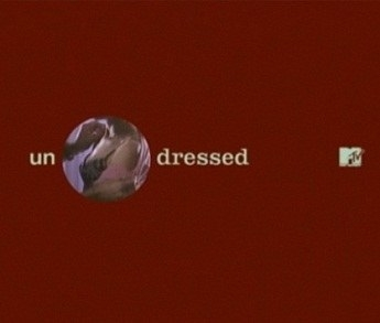A screenshot for the intro to MTV's Undressed which features a hole in the between un and dressed with a clip of two people undressing in it