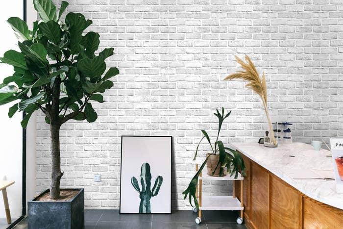 A faux brick wallpaper adhered to a wall