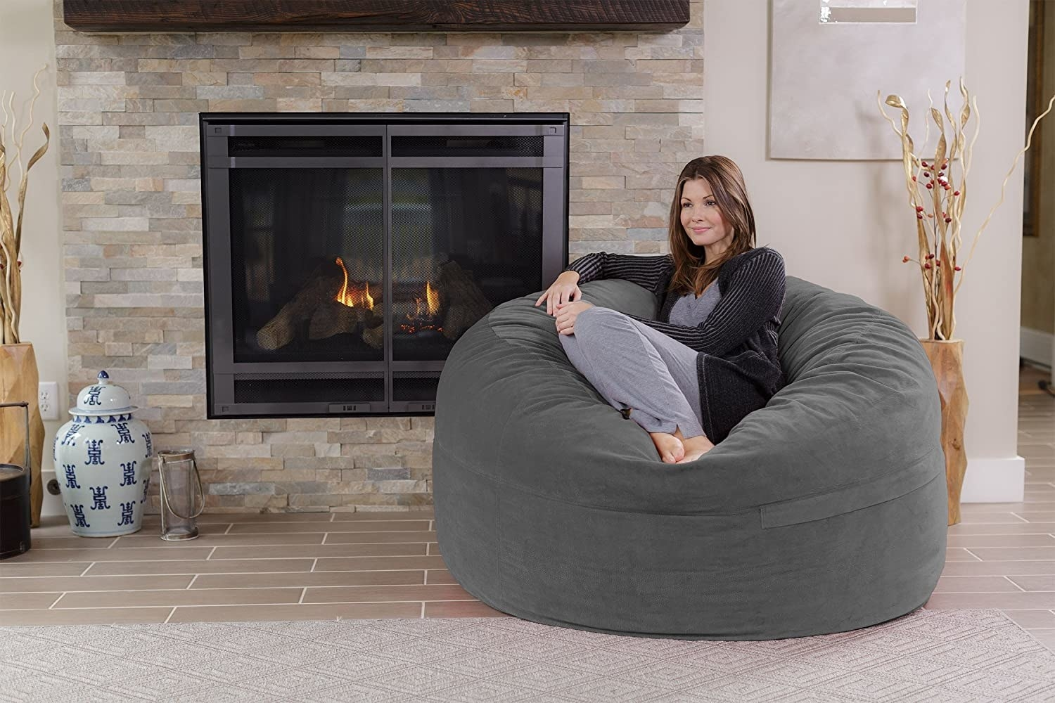 Model in a gray oversized bean bag style lounger