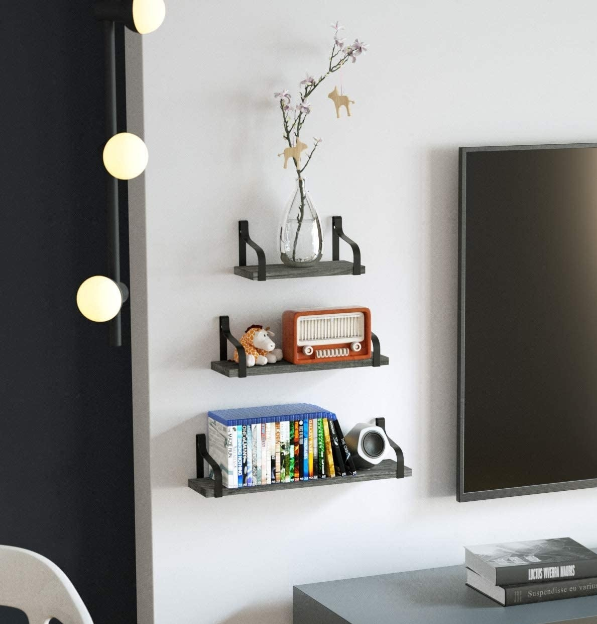 Floating shelves are installed on a wall beside a television