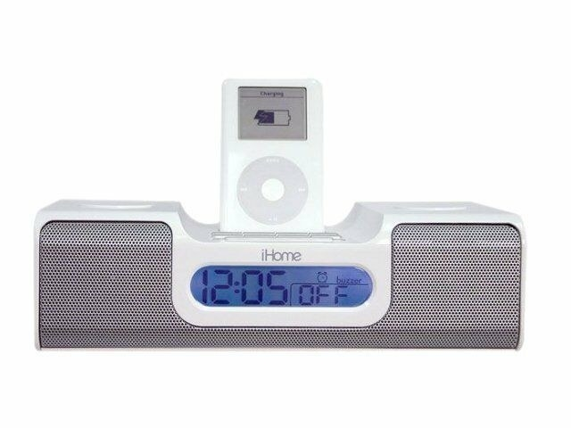 A iHome radio with a iPod attached to the top, charging