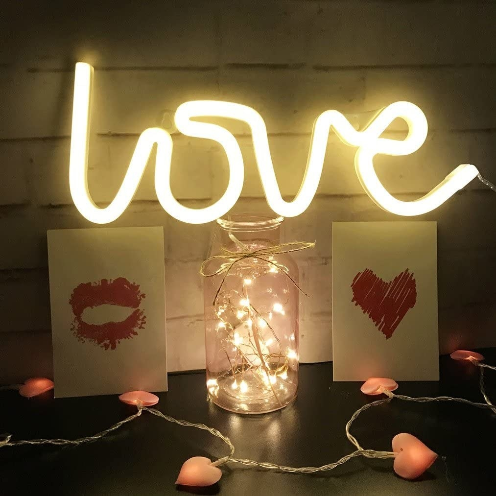 A neon light that says love
