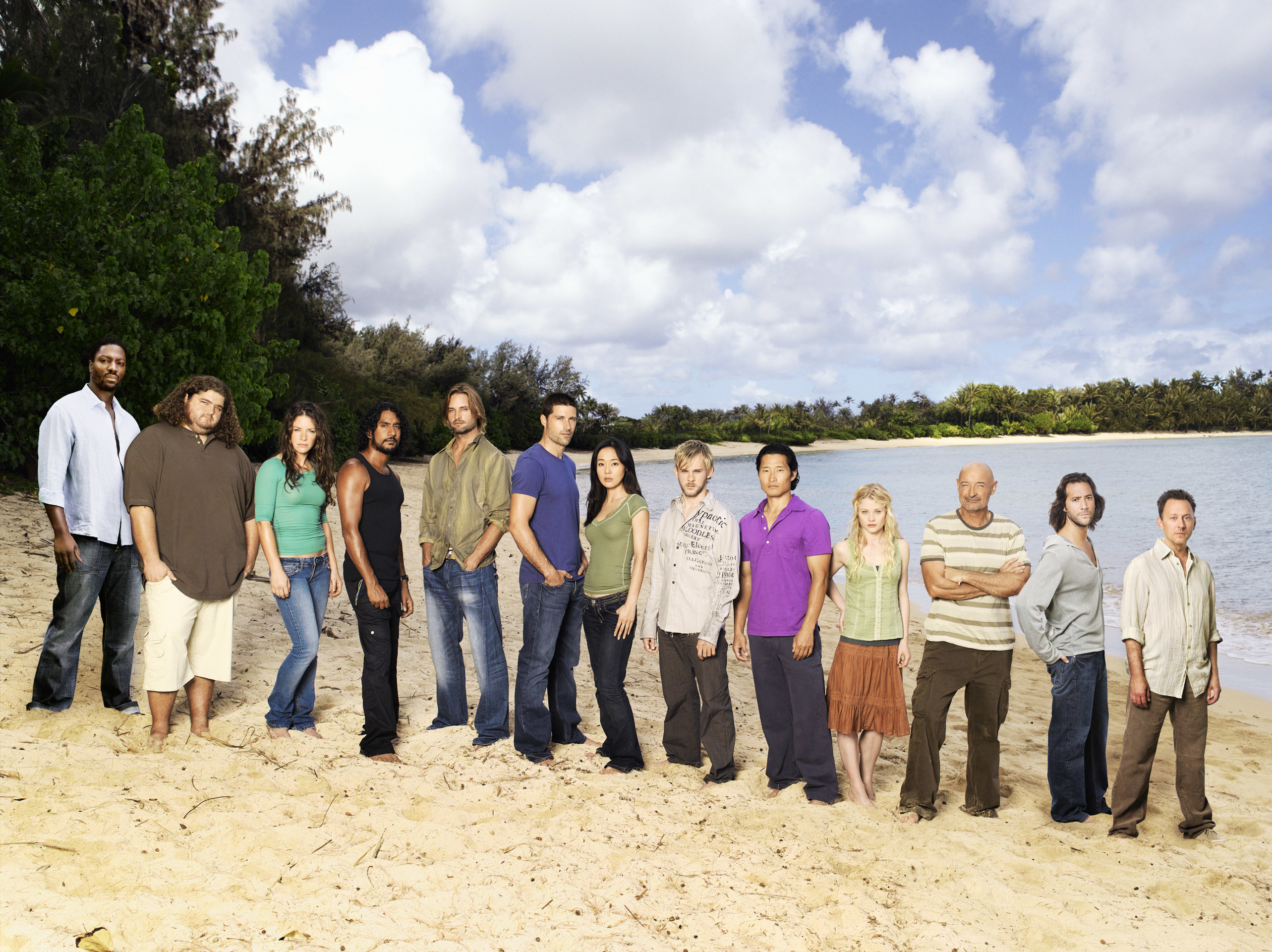 """A publicity photo of the cast of """"Lost"""" standing on a beach"""