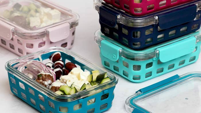 Several meal prep containers with veggies inside of them