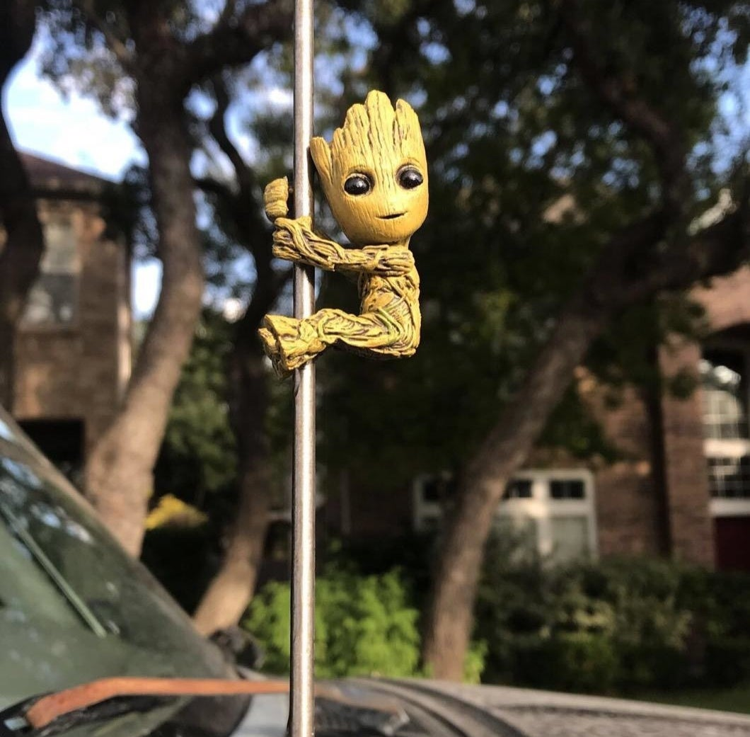 baby groot holds onto antenna