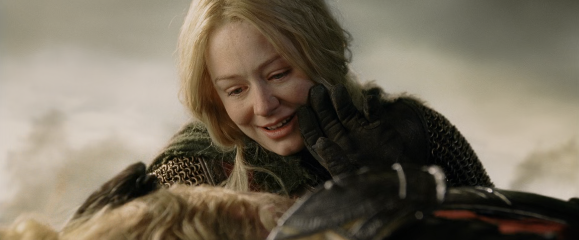 Éowyn looking at Théoden, who is lying on the ground