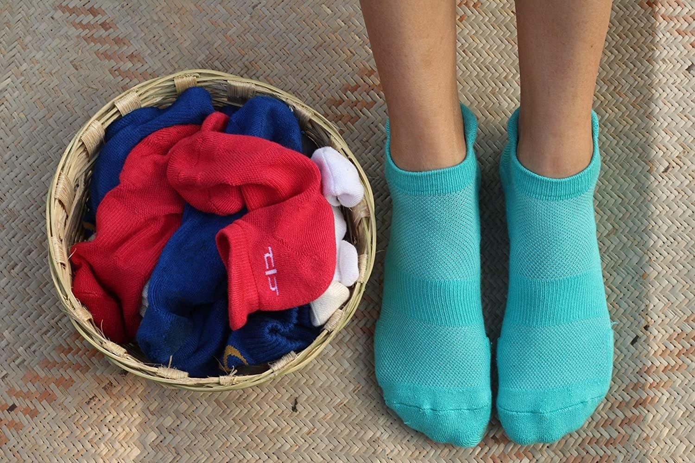 A pair of socks near a hamper of socks