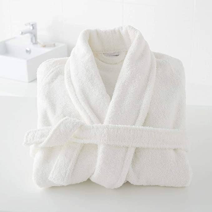 Bathrobe folded neatly on the bathroom counter.