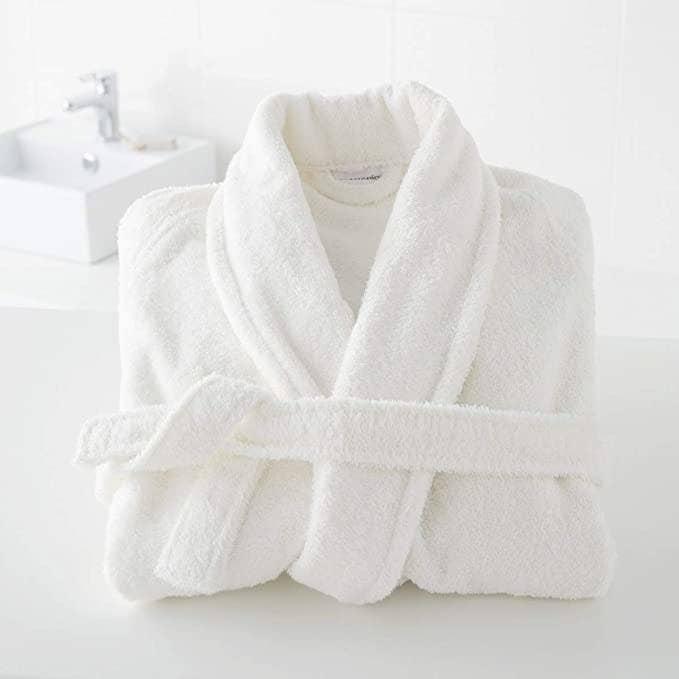 Bathrobe folded neatly on the bathroom counter.