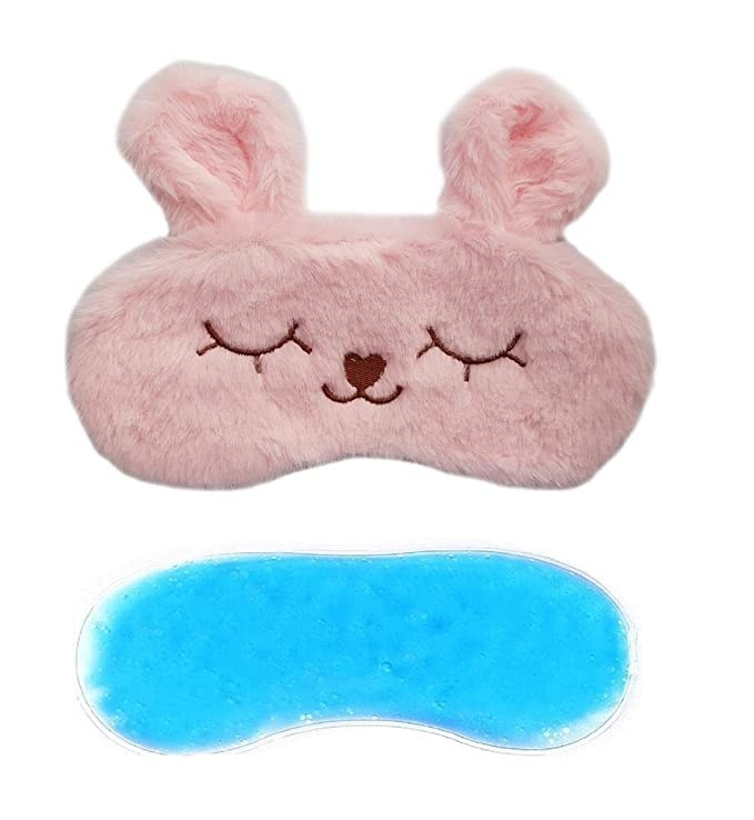 Pink fuzzy eye mask with gel padding.