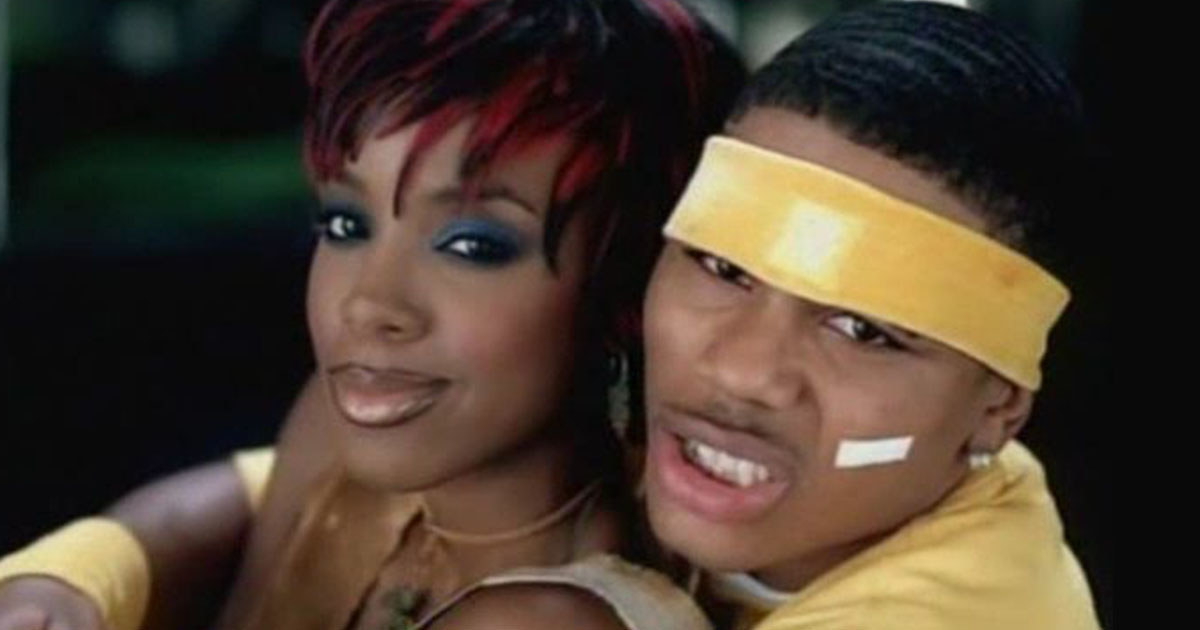 """Screenshot of Kelly Rowland and Nelly hugging in the music video from """"Dilemma"""""""