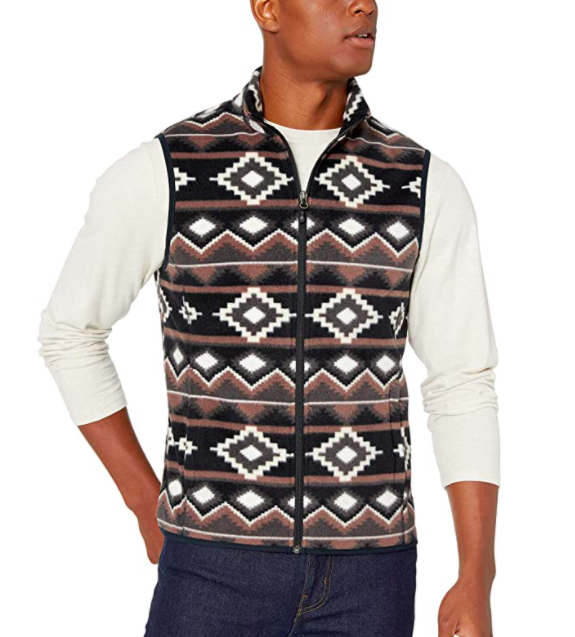 Model wearing Amazon Essentials full zip fleece vest in brown geo