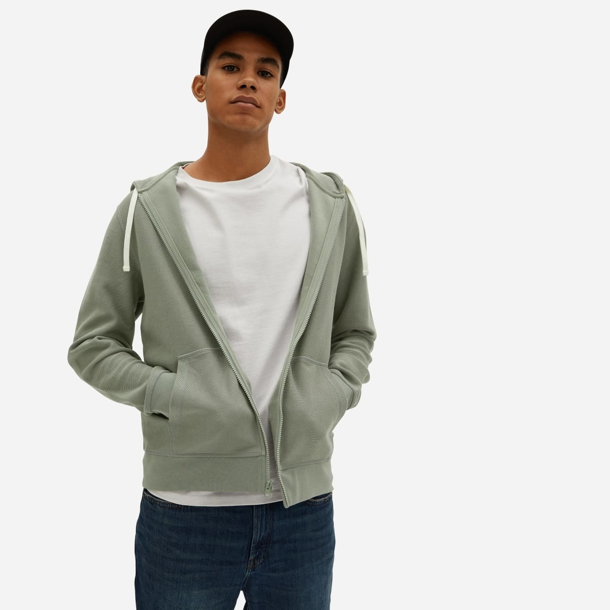 Model wearing the twill full-zip hoodie in light sage