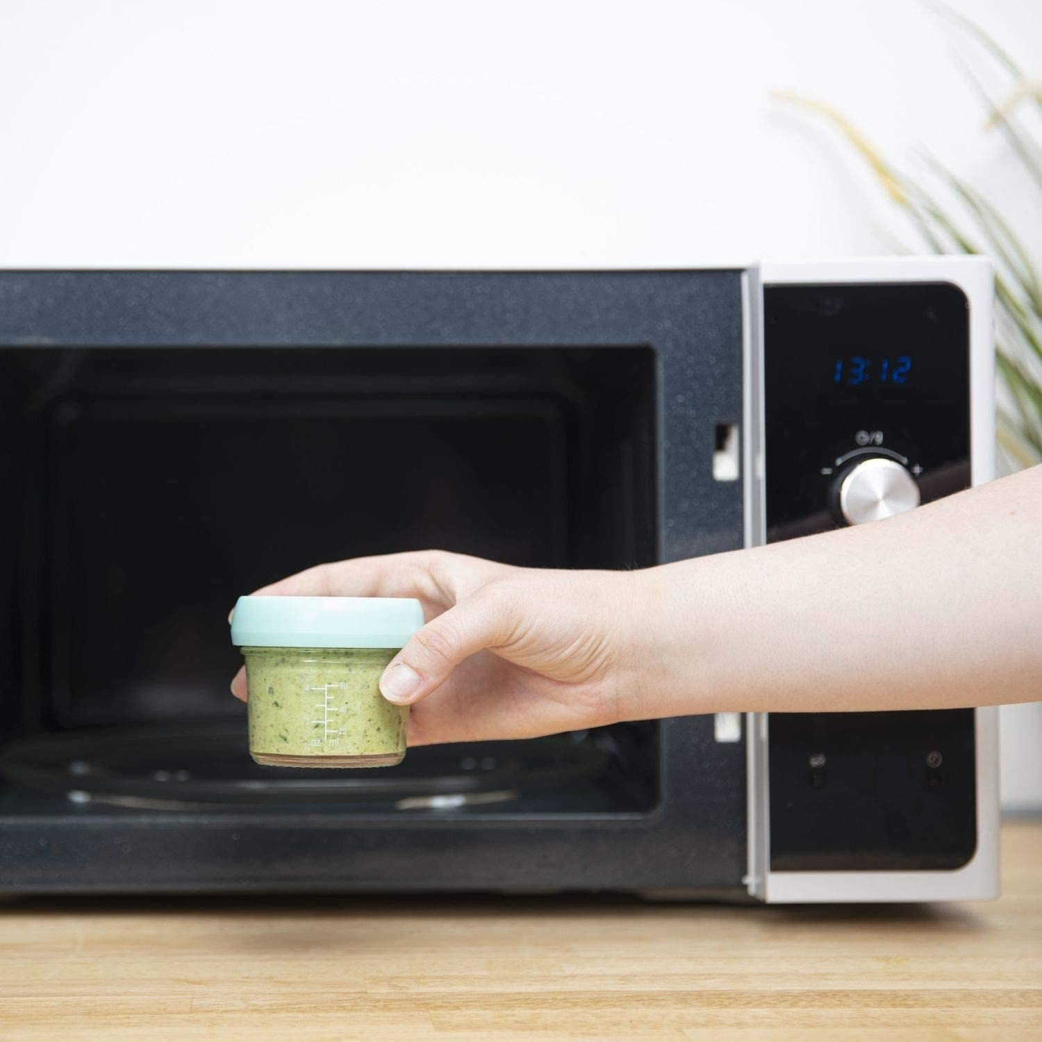 A person putting the container into a microwave