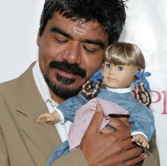 George Lopez with a Kirsten doll