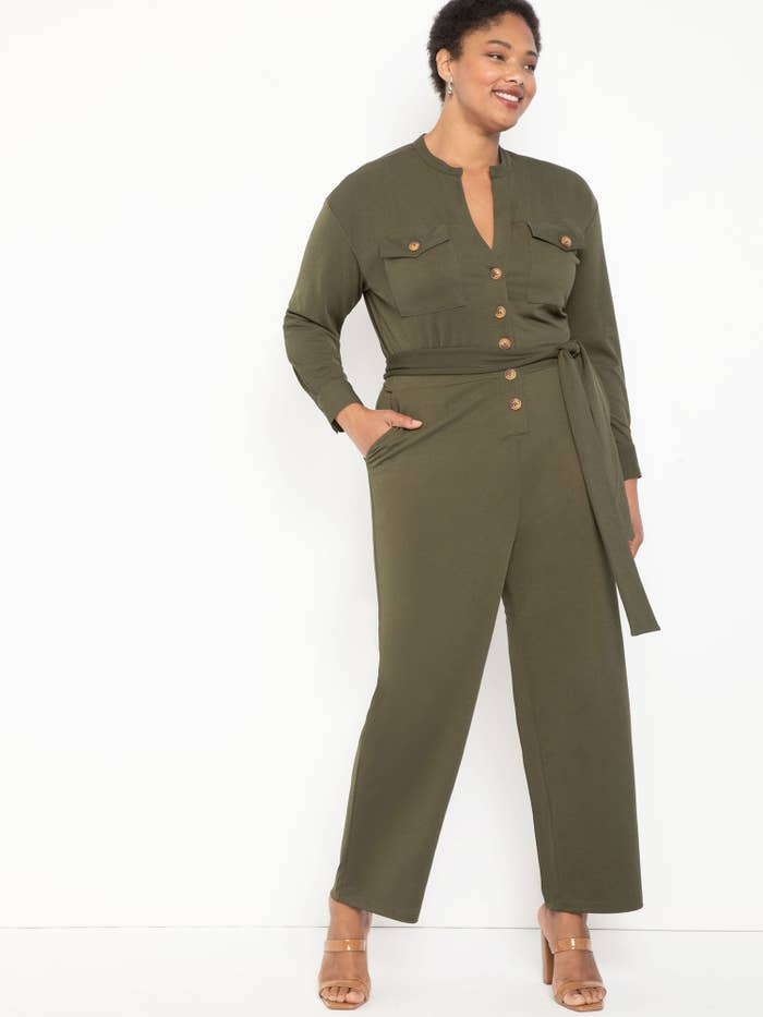 person wearing an olive green jumpsuit