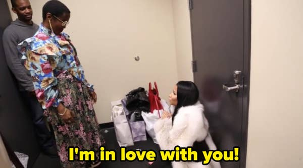 Nicki on her knees in front of Lauryn Hill, telling her how much she loves her