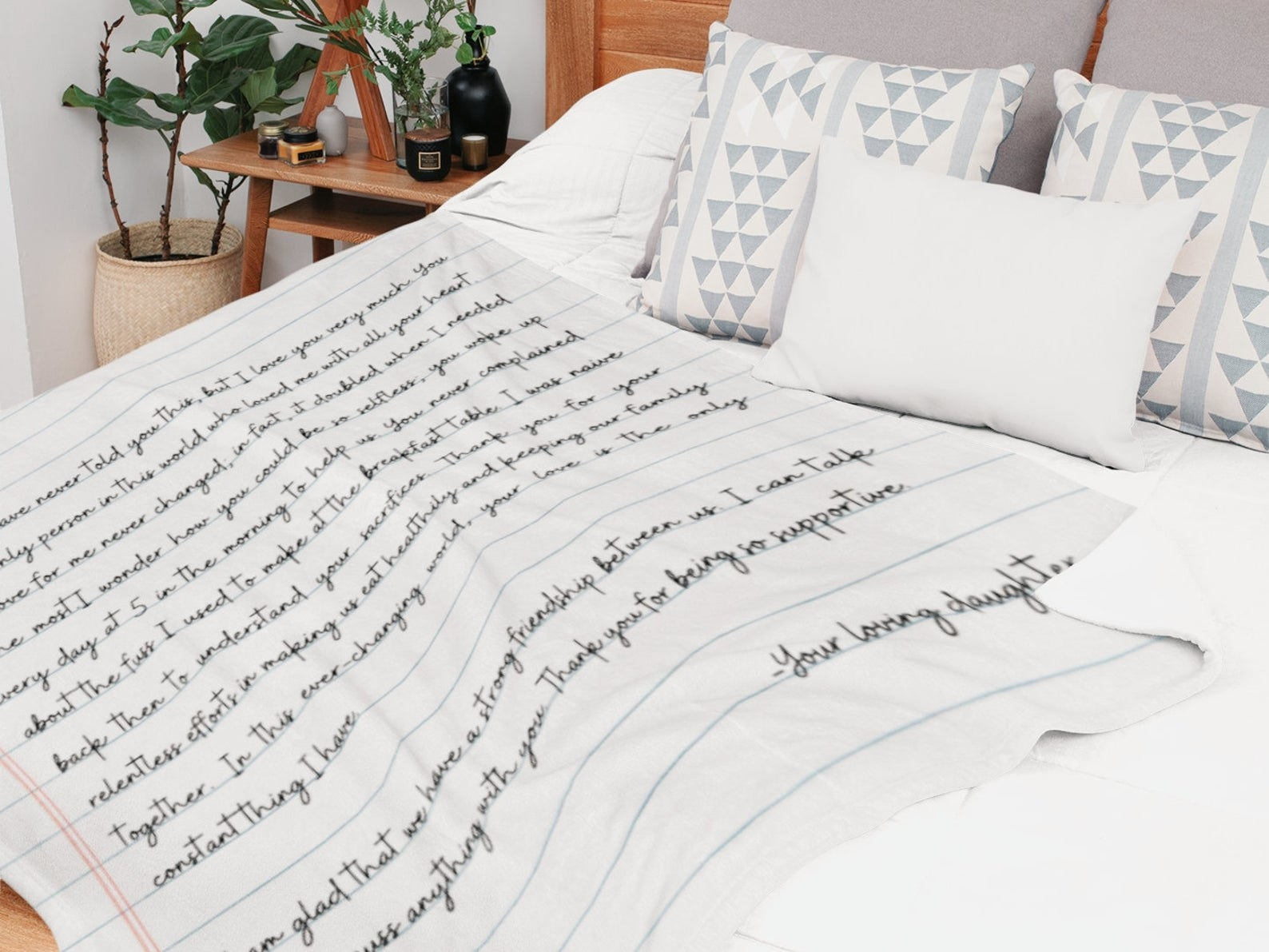 A blanket that looks like a notebook page with writing on it