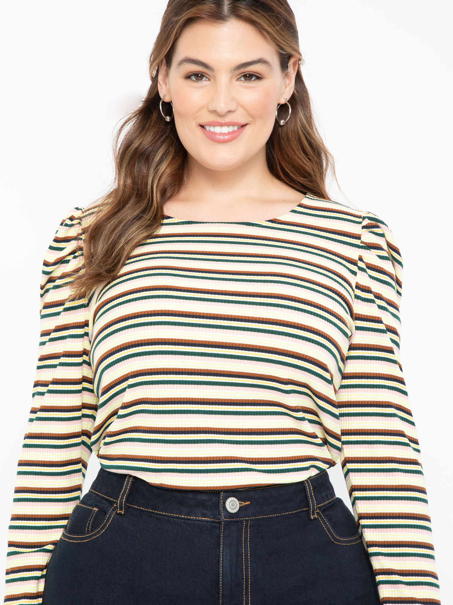 person wearing striped t shirt tucked into a jeans