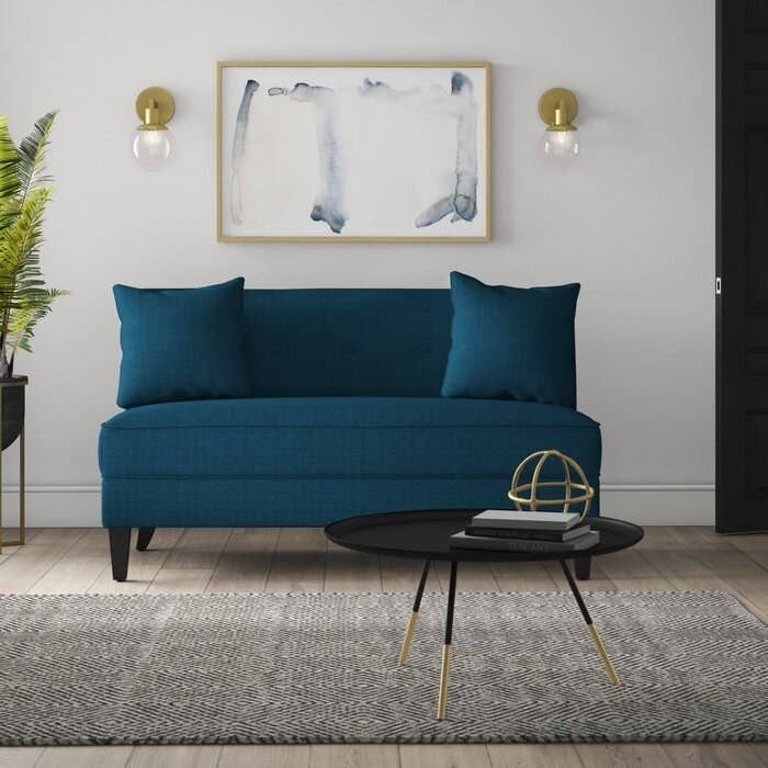 The teal loveseat