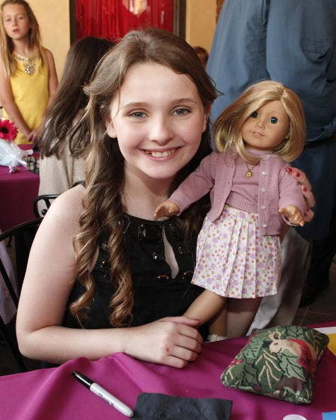 young Abigail Breslin with a Kit doll