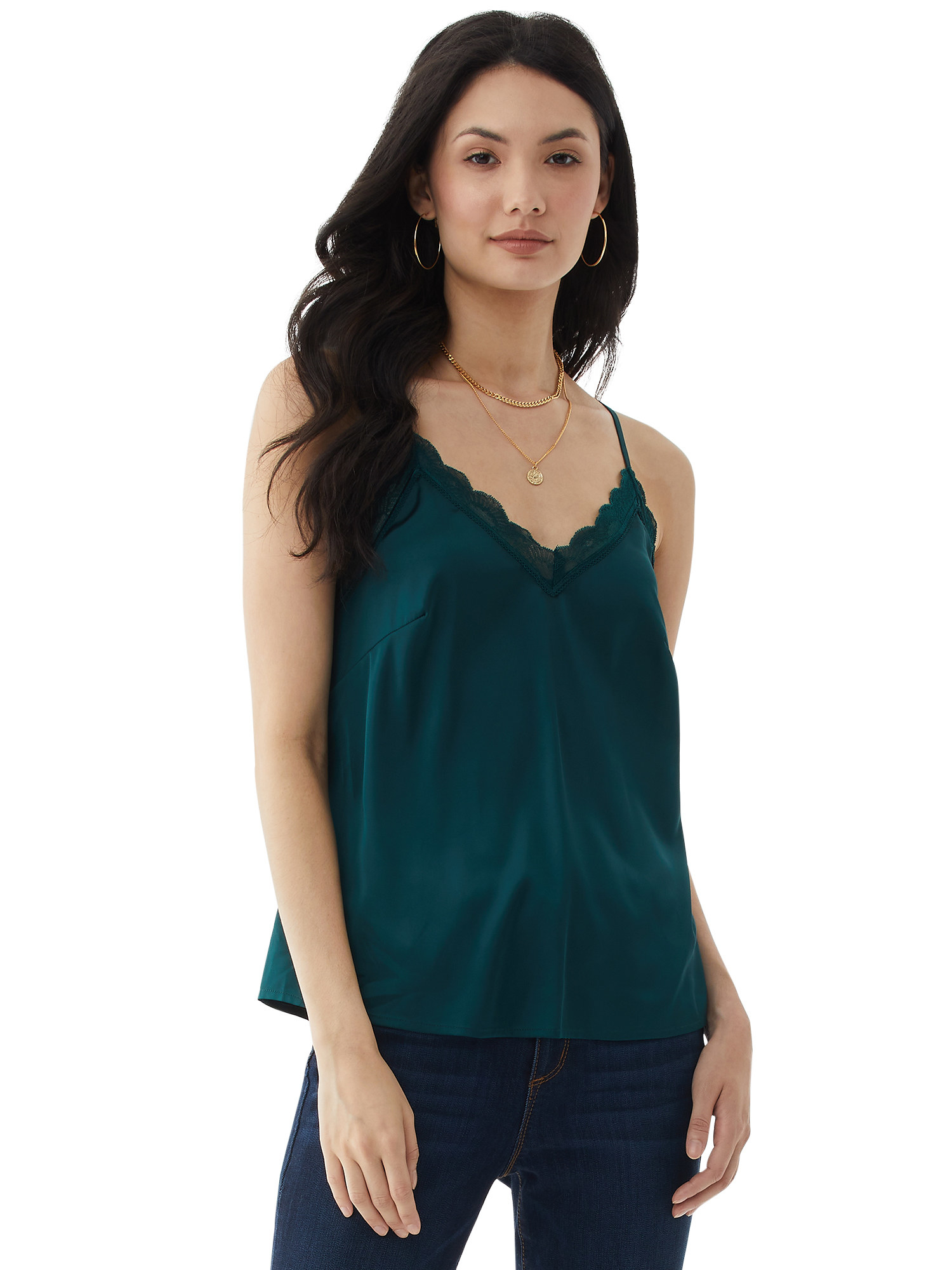 person wearing a hunter green cami tank top over blue jeans