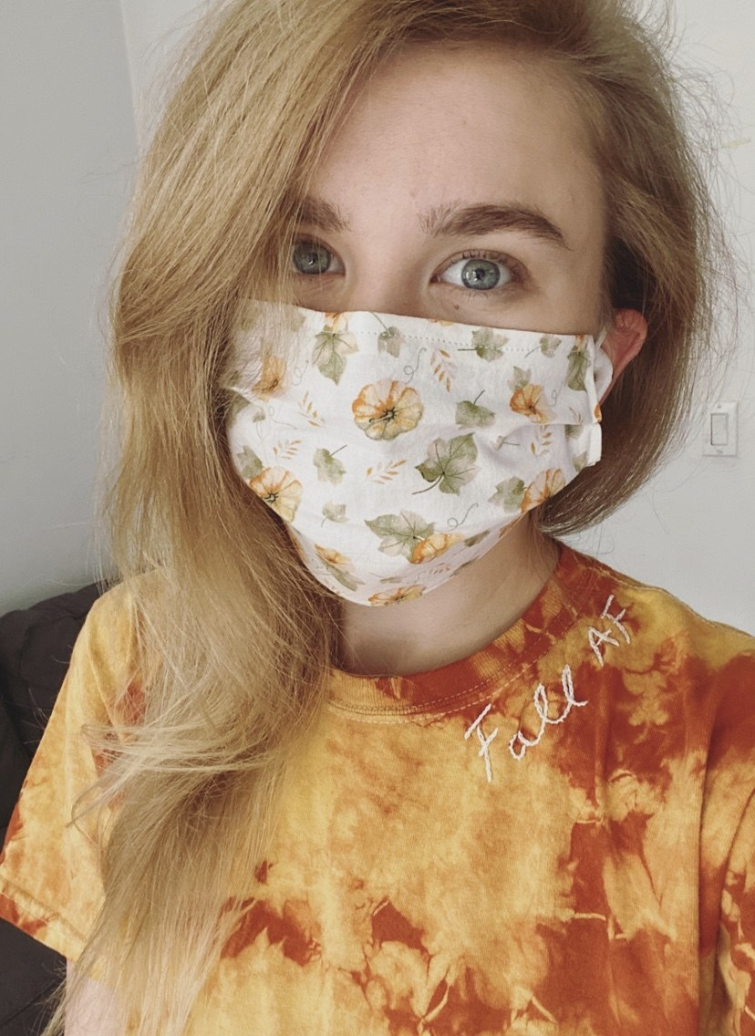 BuzzFeed editor in ivory mask with pumpkin print on it