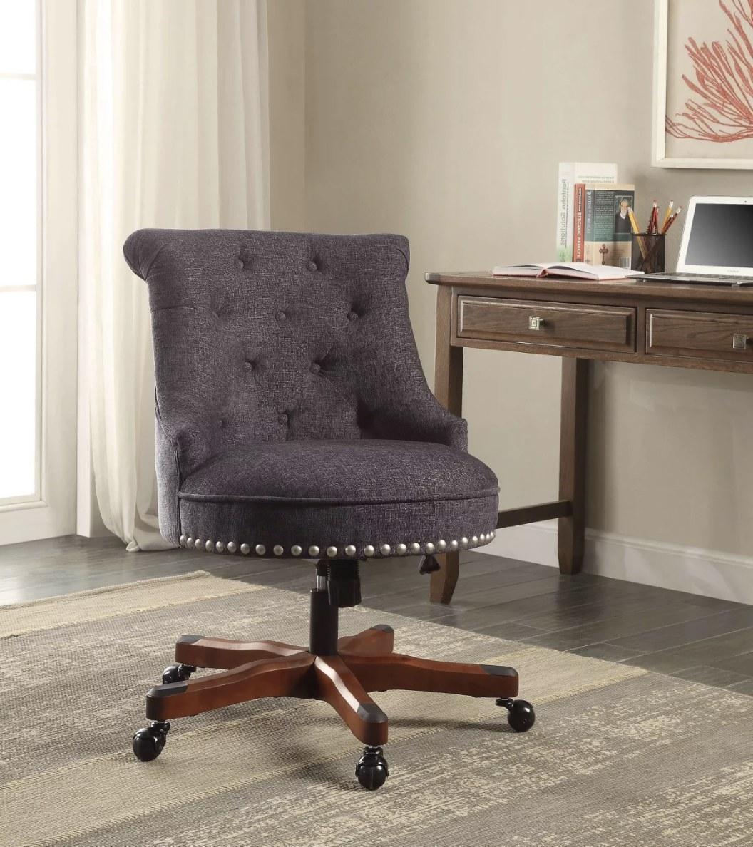 A wheeled armless office chair in dark blue