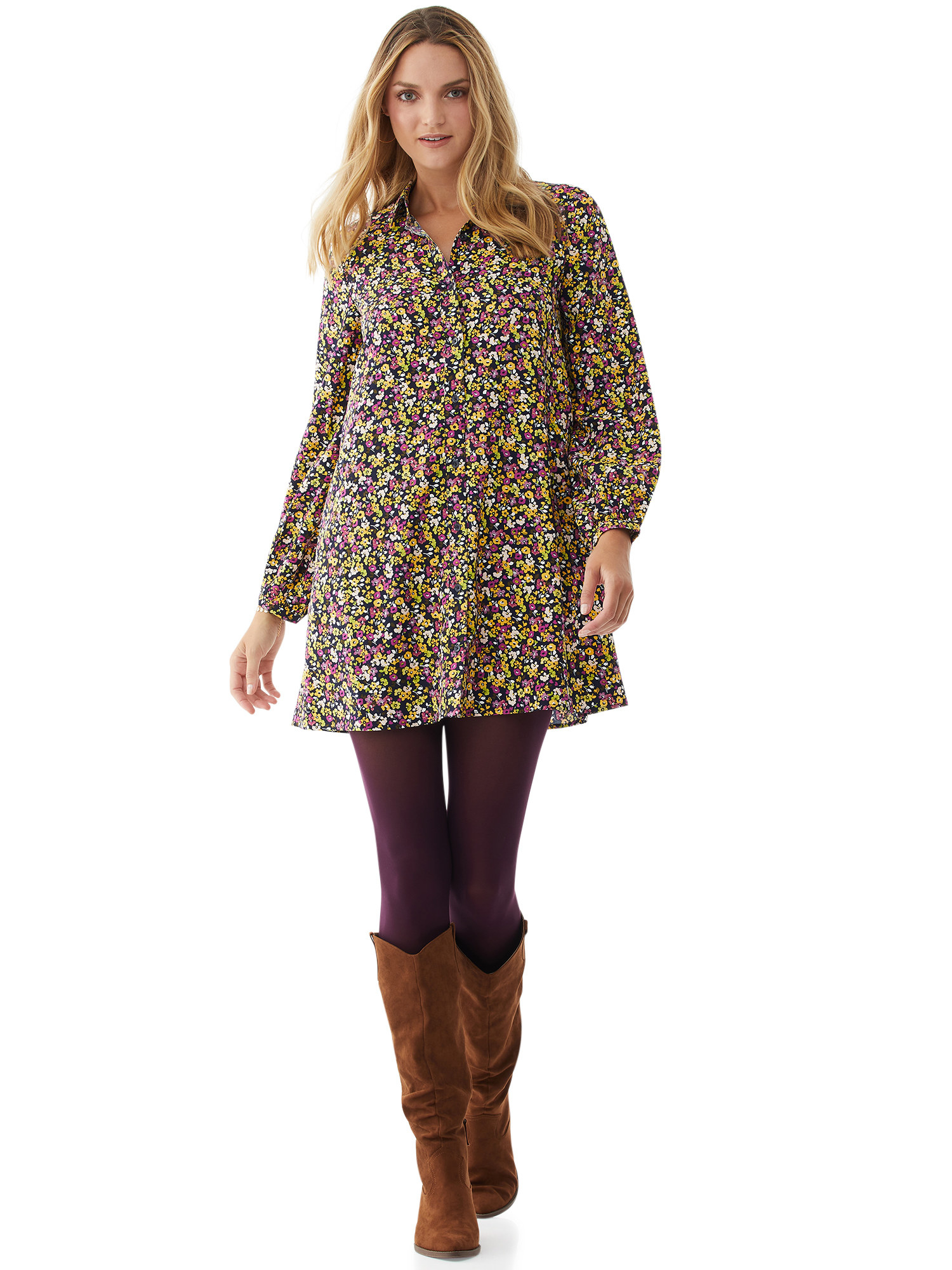 person wearing floral shirtdress with purple leggings and brown boots