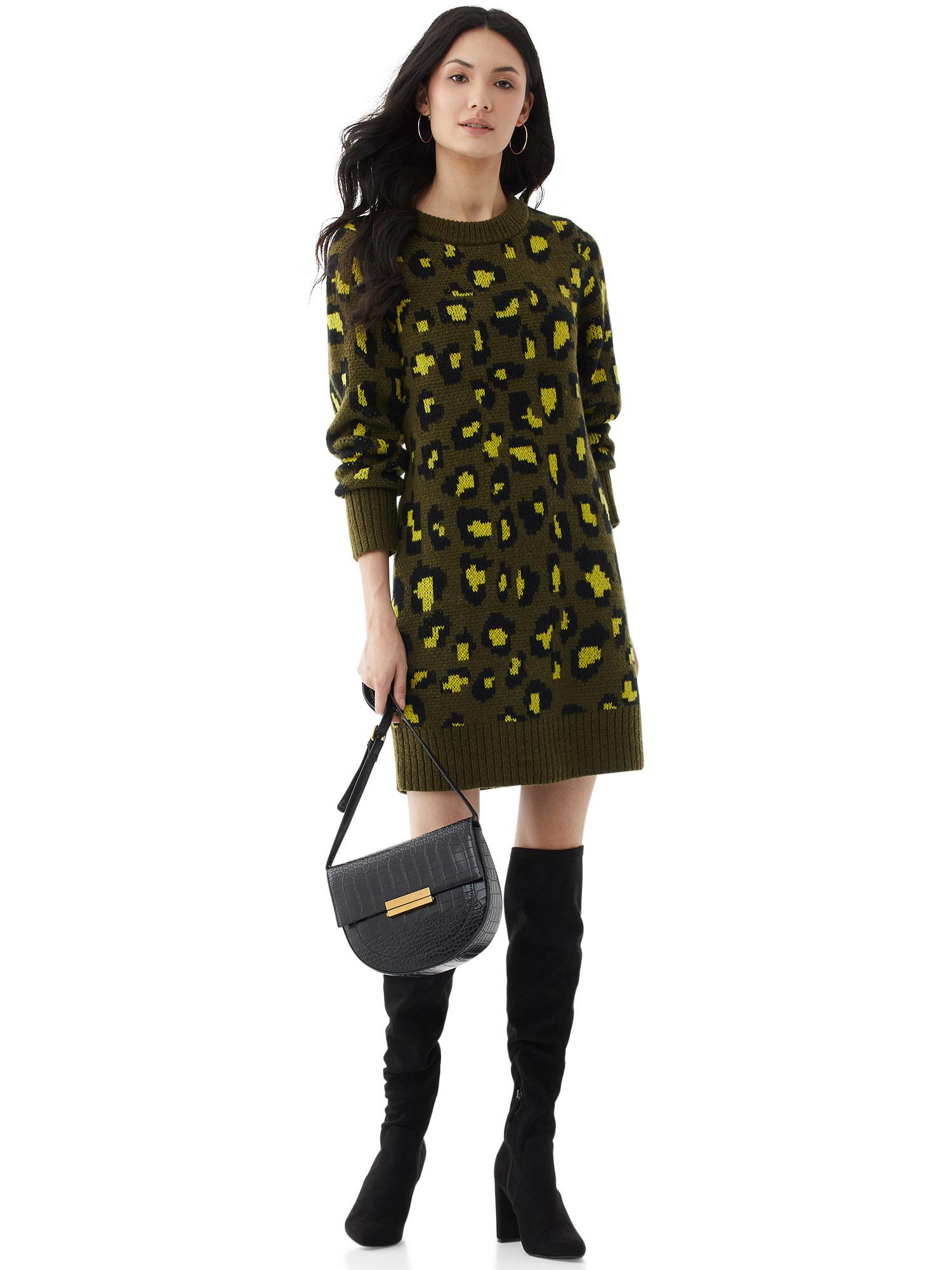 person wearing a green leopard print sweater dress