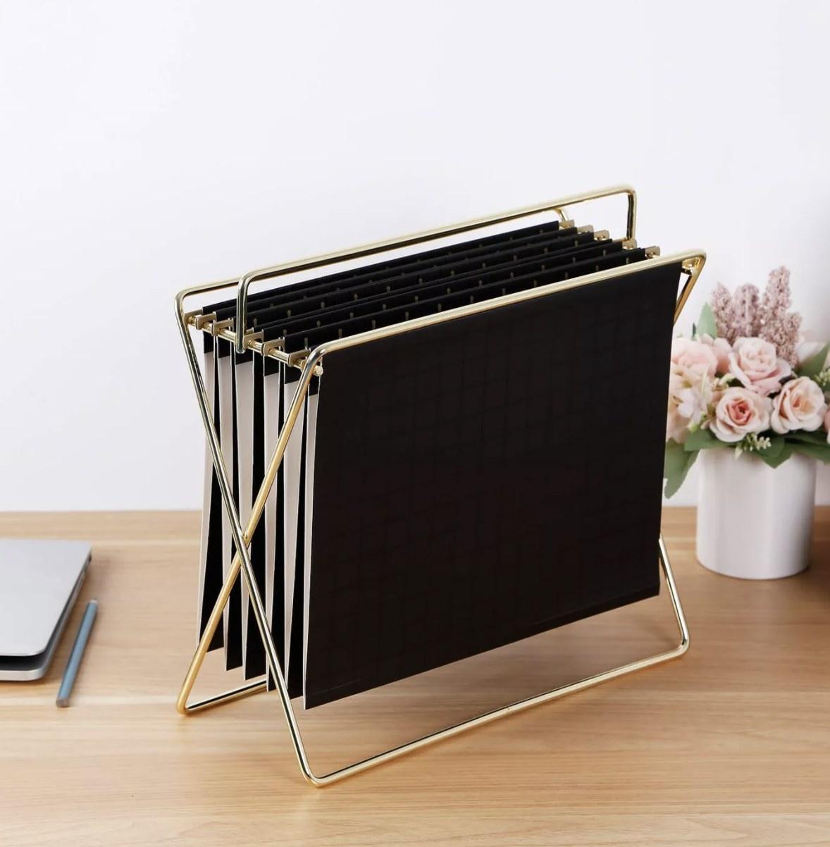 Gold file holder with black hanging folders